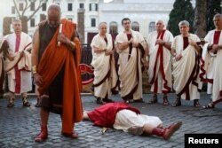 """Members of the Roman historical society """"Gruppo Storico Romano"""" take part in a re-enactment of the """"Ides of March"""", known also as the date on which Julius Caesar was assassinated in 44 B.C., in downtown Rome, March 15, 2013."""