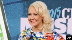 FILE - Meghan Linsey arrives at the CMT Music Awards at Bridgestone Arena in Nashville, Tennessee, June 10, 2015.