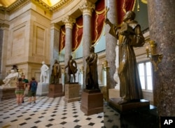 A statue of missionary Junipero Serra, right, is seen in Statuary Hall, also known as the Old Hall of the House, on Capitol Hill in Washington, D.C., July 2, 2015.