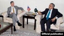 وزیر خزانہ اسحاق ڈار اور امریکی سفیر اولسن