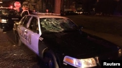 A police car with broken windows is seen in this photograph released by the Milwaukee Police Department after disturbances following the police shooting of a man in Milwaukee, Wisconsin, Aug. 13, 2016.