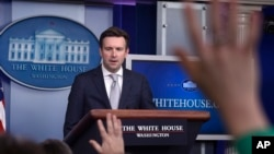 White House Press Secretary Josh Earnest speaks during the daily briefing at the White House in Washington, March 9, 2015.