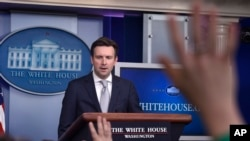 FILE - White House Press Secretary Josh Earnest speaks during the daily briefing at the White House in Washington, March 9, 2015.