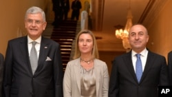 From left, Turkey's European Union Affairs Minister Volkan Bozkir, EU Foreign Affairs and Security Policy Vice President of the Commission Federica Mogherini and Turkish Foreign Minister Mevlut Cavusoglu in Ankara, Dec. 8, 2014.