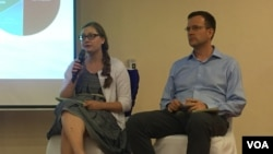 "(Left to right) Courtney Weatherby and Brian Eyler, authors of publication ""Mekong Power Shift: Emerging Trends in the GMS Power Sector"" present their new publication at the Hotel Cambodiana on July 6, 2017. (Chhun Bunchhai/VOA Khmer)"