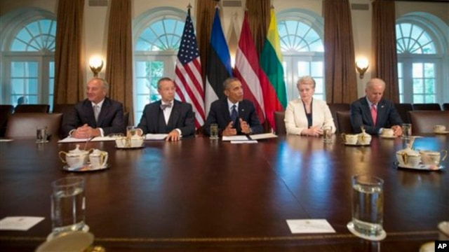 President Barack Obama speaks to members of the media during his meeting with Baltic leaders, from left, Latvian President Andris Berzins, Estonian President Toomas Hendrik Ilves, Lithuanian President Dalia Grybauskaite, and Vice President Joe Biden in th