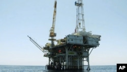 FILE - Platform Holly, an oil drilling rig in the Santa Barbara Channel offshore of Goleta, Calif., will be decommissioned and its operator is seeking bankruptcy protection nearly two years after the platform was idled when an onshore pipeline ruptured and spilled a massive amount of oil into the ocean, the state and Venoco said April 17, 2017.