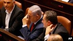 ພາບຂອງທ່ານນາຍົກລັດຖະມົນຕີເບນຈາມິນ ເນຕັນຢາຮູ ກ່ອນຈະລົງຄະແນນສຽງ ໃນສະພາ Knesset ຂອງອິສຣາແອລໃນນະຄອນ Jerusalem, ວັນທີ 29 ພຶດສະພາ, 2019 ເພື່ອຍຸບສະພາ ແລະກຳນົດວັນເລືອກຕັ້ງ ກ່ອນສະໄໝອີກຄັ້ງນຶ່ງ.