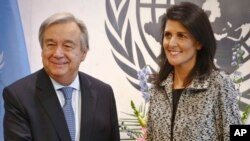 Former South Carolina Governor Nikki Haley poses with U.N. Secretary General Antonio Guterres after presenting him with her credentials as the new U.S. ambassador to the United Nations at U.N. headquarters, Jan. 27, 2017.