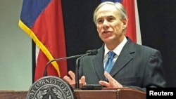 Texas Attorney General Greg Abbott speaks at a news conference in Austin, Texas, about a lawsuit challenging the president's use of an executive order to ease the threat of deportation for some undocumented immigrants, Dec. 3, 2014.
