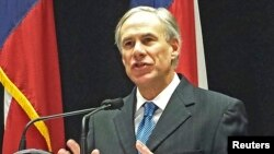 FILE - Texas Governor Greg Abbott is among more than two dozen governors, mostly Republicans, who have vowed to keep Syrian refugees from resettling in their states.