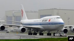 FILE -- The first Boeing 747-8 intercontinental airplane to be delivered to Air China is moved into position from Boeing's assembly facility to Paine Field in Everett, Wash., Sept. 29, 2014.