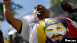 A supporter of jailed opposition leader Leopoldo Lopez shouts slogans, Dec. 6, 2016, during a protest calling for the government of Venezuela's President Nicolas Maduro to order the release of political prisoners. On Tuesday, Dec. 13, 2016, four opponents of Maduro were released.