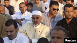 Mohammed Magarief (C), president of the Libyan National Assembly, attends Eid al-Fitr prayers in Benghazi August 19, 2012.