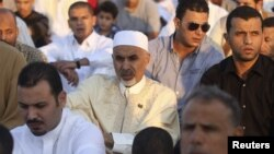 Mohammed Magarief, center, then-president of the Libyan national assembly, attends Eid al-Fitr prayers in Benghazi in this August 19, 2012, file photo.