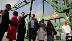 New York Governor Andrew Cuomo speaks with his delegation and Cuban officials as they visit a port's container terminal in the Bay of Mariel, Cuba, April 21, 2015.