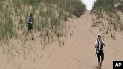 Pam Riehl Szakal and Sue Segel trek through the sand dunes during the Stark Raving Mad adventure race.