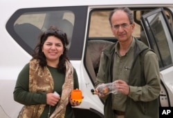 FILE - Undated photo provided by the family of the late Iranian-Canadian professor Kavous Seyed-Emami, shows him and his wife, Maryam Mombeini in an unidentified place in Iran.