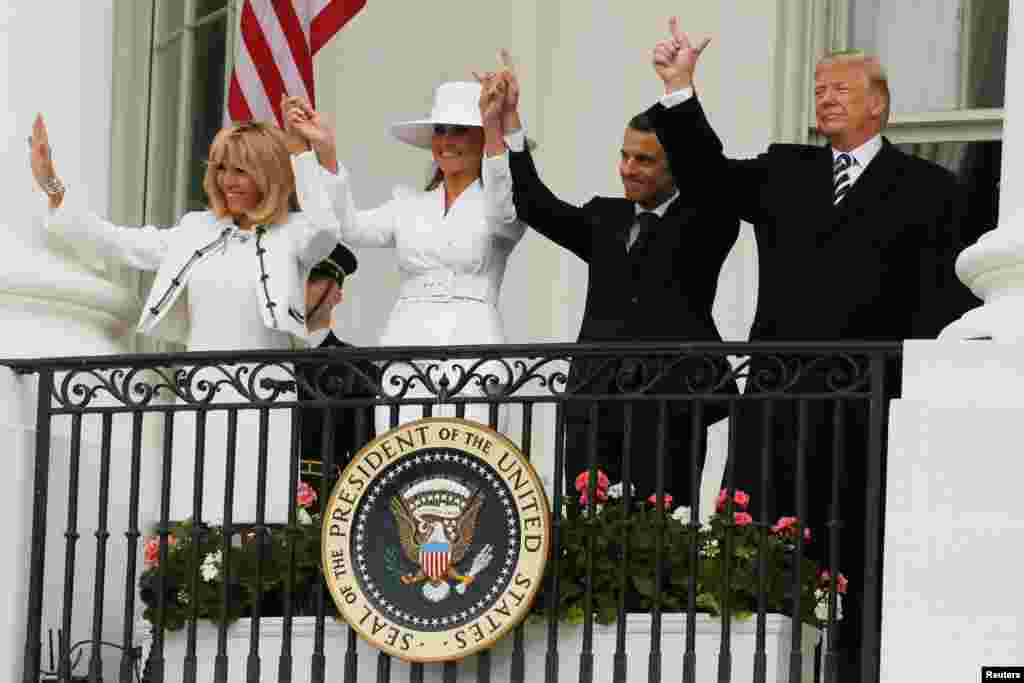 U.S. President Donald Trump, first lady Melania Trump and French President Emmanuel Macron and his wife Brigitte Macron gesture during an arrival ceremony at the White House in Washington, Apr. 24, 2018.