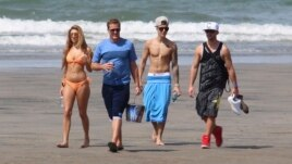 Justin Bieber, second right, and Chantel Jeffries, far left, walk with unidentified people on a beach in Punta Chame, Panama, Jan. 25, 2014.