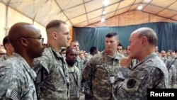 General Martin Dempsey, right, chairman of the Joint Chiefs of Staff, speaks to U.S. troops at Baghdad International Airport in Iraq, Nov. 15, 2014.