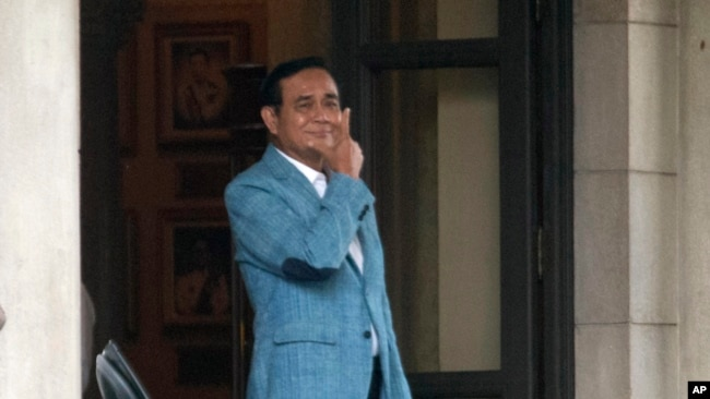 Thai Prime Minister Prayuth Chan-ocha leaves the government house in Bangkok, Thailand, Friday, Feb. 8, 2019. (AP Photo/Sakchai Lalit)