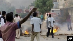 In this citizen journalism image, tires burn during a protest in Khartoum, Sudan.
