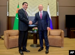 Russian President Vladimir Putin, right, meets with Turkmenistan's President Gurbanguli Berdymukhamedov last year in Russia.
