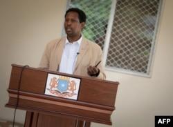 FILE - Abdirahman Omar Osman, spokesperson of the President of Somalia, addresses the Somali media, Oct. 25, 2013. (AFP Photo / AU-UN IST Photo / Stuart Price)