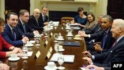 U.S. President Barack Obama and Vice President Joe Biden (R) meet with Prime Minister of Georgia Irakli Garibashvili (L) in the Roosevelt Room at the White House in Washington, D.C., Feb. 24, 2014.
