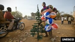 Street vendor in Juba, South Sudan, selling plastic Christmas trees and inflatable balls made in China. (Photo: UNESCO/Sven Torfinn/Panos)