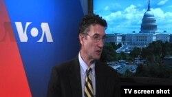 Mark Gruin, Međunarodna organizacija za pomoć pravoslavcima