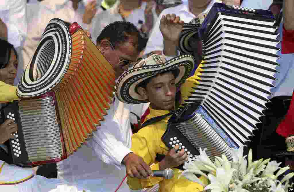 A boy plays the accordion during a musical homage to singer and composer Diomedes Diaz at the main square of Valledupar, in Colombia's northern state of Cesar, Dec. 25, 2013. Diomedes Diaz, one of the greatest performers of the country's accordion vallenato music, died on Dec. 22, 2013, at age 56.