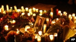 A picture of U.S. Representative Gabrielle Giffords (D-AZ) is surrounded by candles during a vigil outside the Tucson University Medical Center in Tucson, Arizona, 08 Jan 2011.