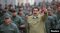 Venezuela's President Nicolas Maduro gestures during a meeting with soldiers at a military base in Caracas, Venezuela January 30, 2019. Miraflores Palace/Handout via REUTERS ATTENTION EDITORS - THIS PICTURE WAS PROVIDED BY A THIRD PARTY. TPX IMAGES O