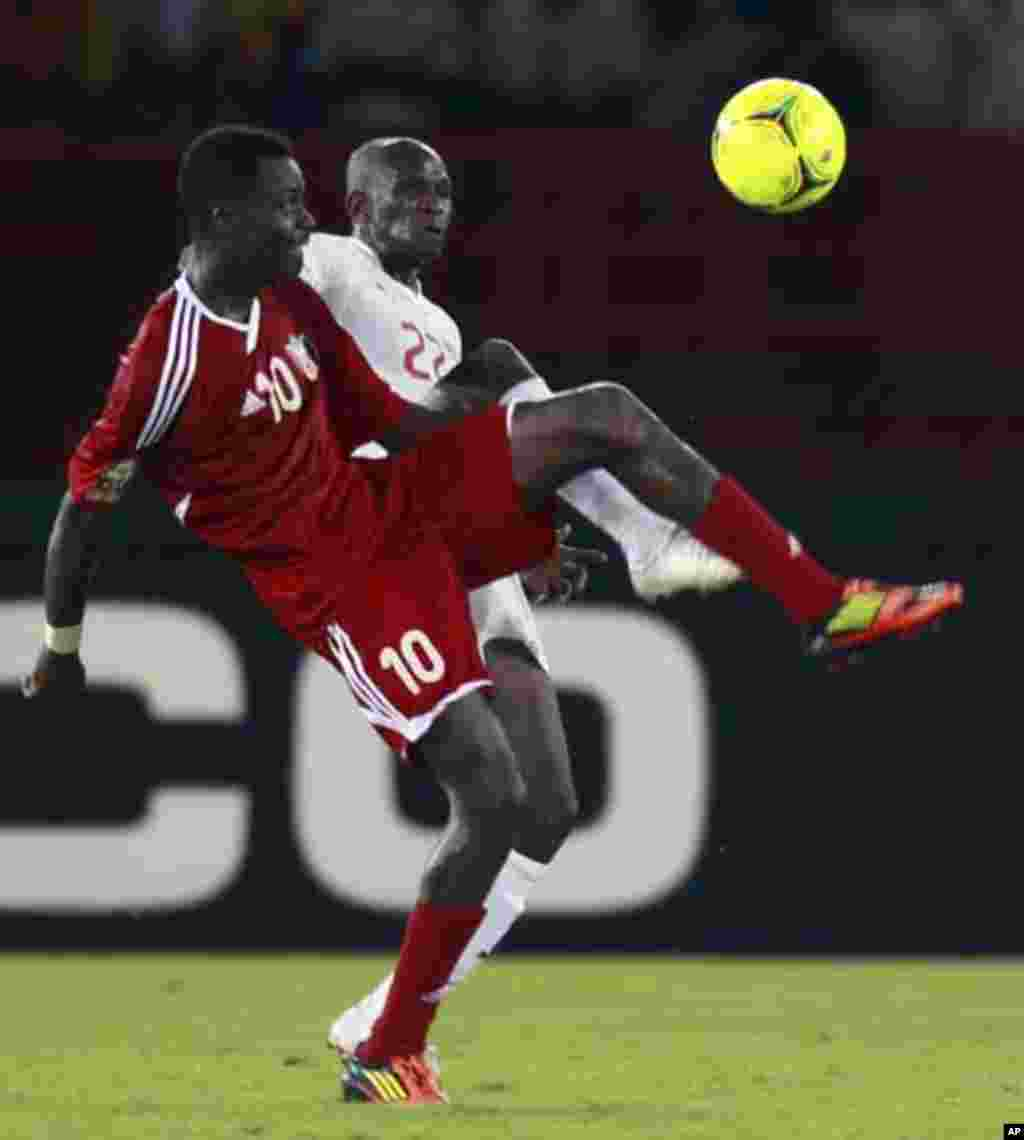 "Saidou Panandetiguiri of Burkina Faso (R) fights for the ball with Muhannad Tahir of Sudan during their African Nations Cup Group B soccer match at Estadio de Bata ""Bata Stadium"", in Bata January 30, 2012."