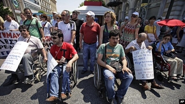 Protesters participate in a rally against the government's latest austerity measures and plans to sell off state enterprises in central Athens, June 18, 2011