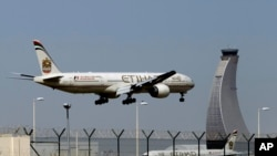 FILE - An Etihad Airways plane prepares to land at the Abu Dhabi airport in the United Arab Emirates.