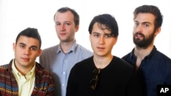 This March 14, 2013 photo shows members of the band Vampire Weekend, from left, Rostam Batmanglij, Chris Baio, Ezra Koenig, and Chris Thomson posing during the SXSW Music Festival in Austin, Texas.