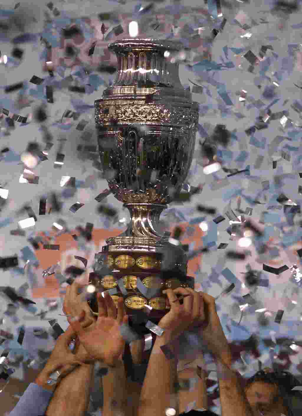 Uruguay's players hold the Copa America while celebrating at the end of the final soccer match with Paraguay in Buenos Aires, Argentina, Sunday, July 24, 2011. Uruguay won the Copa America for a record 15th time after beating Paraguay 3-0 with two goals s
