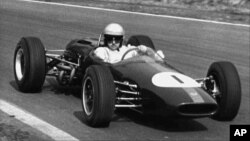 FILE - Australian racing driver Jack Brabham competes at Oulton Park, in Cheshire, England, April 3, 1965.