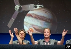 Scott Bolton, left, and Rick Nybakken celebrate Juno starting its orbit of Jupiter.