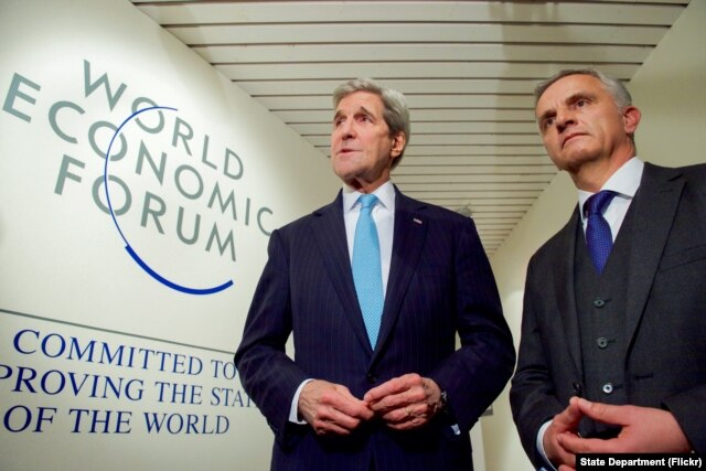 U.S. Secretary of State John Kerry shakes hands with Switzerland Foreign Minister Didier Burkhalter, at the World Economic Forum in Davos, Switzerland, Jan 21, 2016.