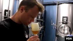 Thomas Gesink of Brewery de Prael in Amsterdam tastes beer made from rainwater.