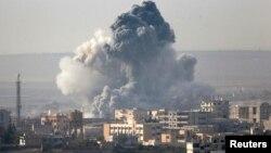 """""""伊斯蘭國""""激進分子圍攻敘利亞城市科巴尼。"""