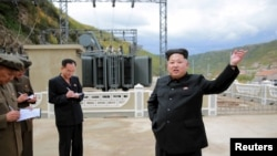 FILE - North Korean leader Kim Jong Un (R) gives field guidance during a visit to a construction site.