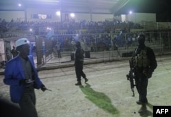 Somali security forces patrol during the soccer match between the Hodan and Waberi districts at Konis Stadium, renovated by FIFA, in Modadishu, Somalia, Sept. 8, 2017. It was the city's first night game in 30 years.