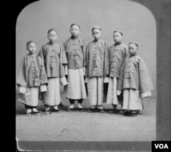 Six boys from the first detachment in 1872, shortly after arriving in San Francisco. From left to right: Chung Mun Yew, Liang Tun Yen, unidentified, Sze Kin Yung, unidentified, New Shan Chow. (Public domain photo)