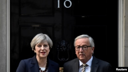 FILE - Britain s Prime Minister Theresa May welcomes Head of the European  Commission b5bfba6618