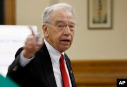 FILE - Sen. Chuck Grassley, R-Iowa speaks at a town hall meeting in Greenfield, Iowa, June 2, 2017.